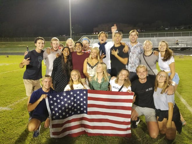 A group of Danish students from the University of North Carolina displaced by Hurricane Florence attend a Fairview High School football game Friday, Sept. 14, 2018.