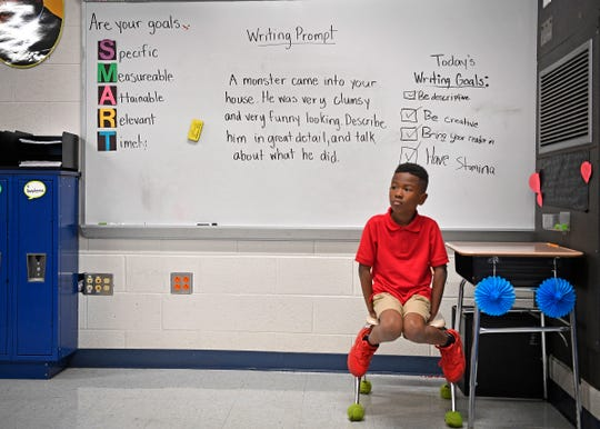 After having problems in his own class earlier in the day, Third grader Tyreese Buchanan has an opportunity to watch Jiff Burnell's forth grade students at Fall Hamilton Elementary to learn how they act. Thursday Sept. 13, 2018, in Nashville, Tenn.