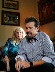Veteran Christian artist Russ Taff, right, talks about his childhood and his lifelong struggles with alcoholism, at his Bell Buckle home on Friday, Sept. 14, 2018 as his wife Tori Taff, left, listens to his story. Taff is coming out with an autobiographical film about his addition that will be released soon.