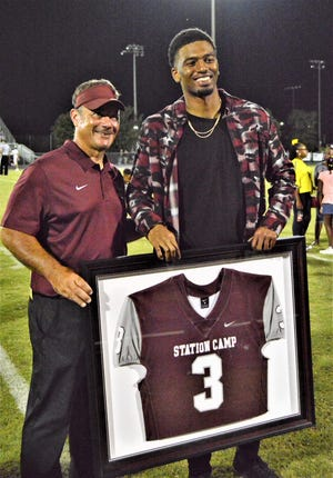 Former Station Camp standout Josh Malone had his jersey retired prior to the Bison's game on Friday.