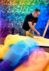 Cheekwood's 2018 Artist-in-Residence, Gabriel Dawe, works with colorful tulle fabric for his site-specific installation in the Museum of Art gallery on Sept. 11, 2018, in Nashville.