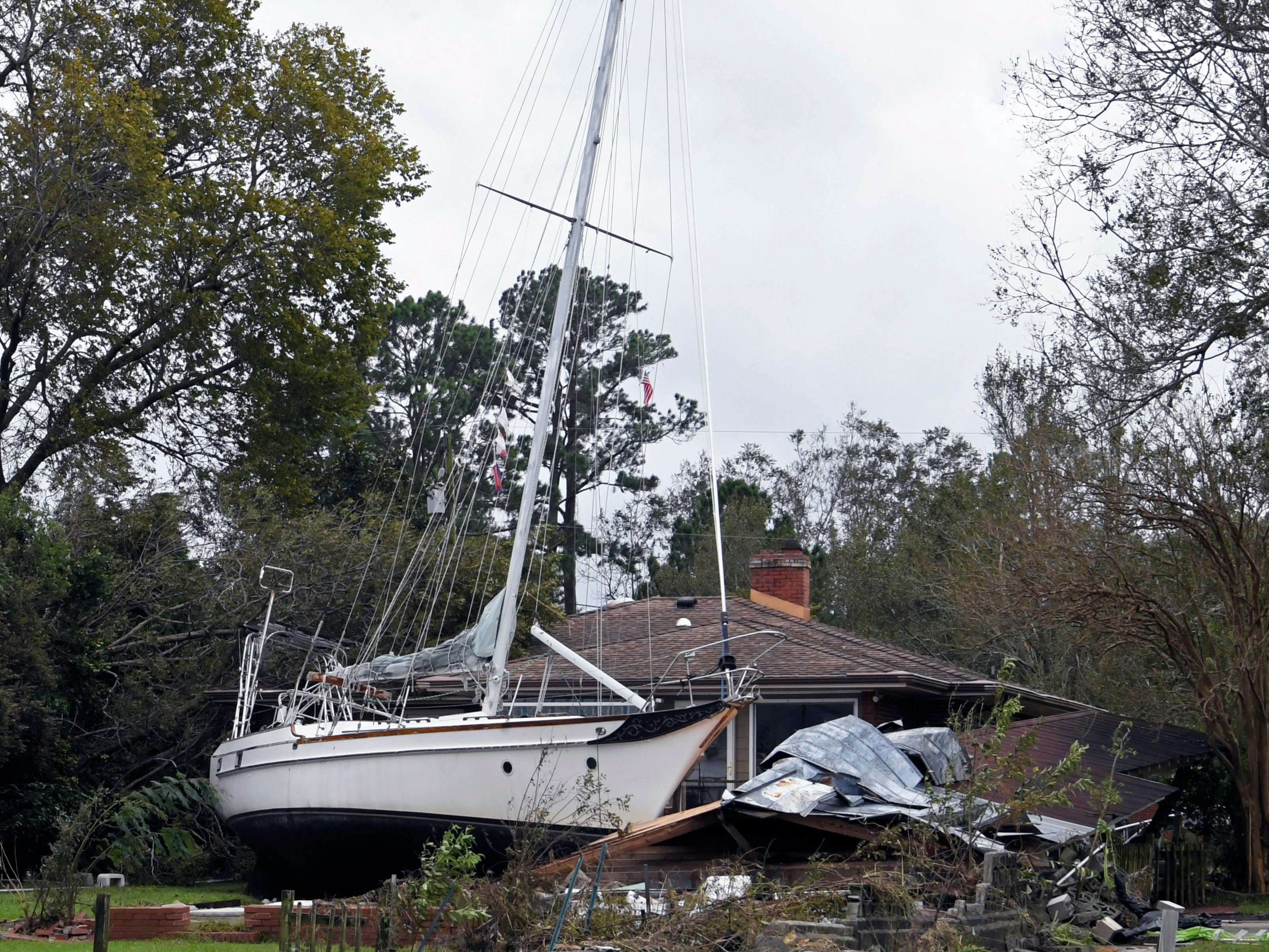 A large sailboat rests in a New Bern, N.C., backyard  on Sunday, Sept. 16, 2018 after flooding from Hurricane Florence.