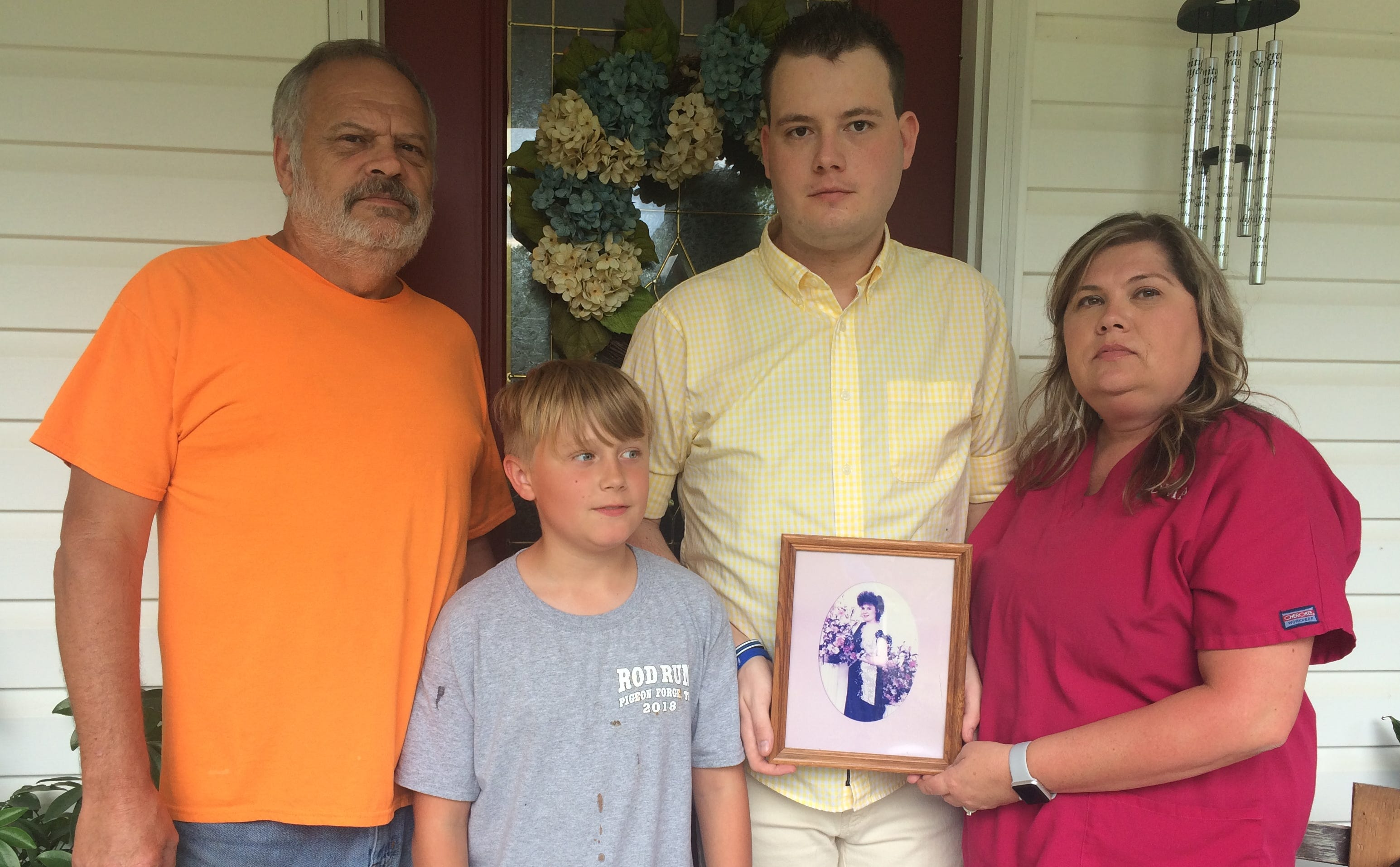 Pictured, from left Charles Newberry, Caden Newberry, D.J. Tucker, and Brandy Richardson. Tucker is the son of Karie Ann Newberry, who was shot and killed in 1993. Charles is Karie Ann's father and Brandy is her sister. Tucker holds a photo of his mother.