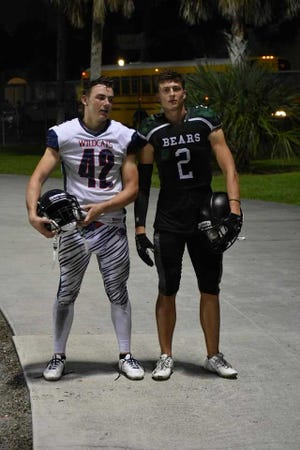 Ian Ellis, left, of Estero, and Ryan Ciresi, of Palmetto Ridge, lined up against each other during Friday night's game. The close-knit cousins had never played with or against one another before Friday night's 46-21 Palmetto Ridge win.