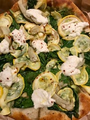 The grilled artichoke and pesto pizza at True Food Kitchen.