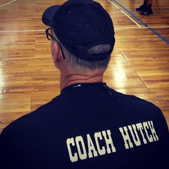 "Dale ""Hutch"" Hutcherson watches volleyball from the sideline. Hutcherson passed away Aug. 15, 2018 after suffering from aphasia for about four years."