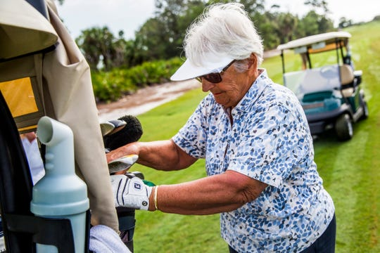 Carol Thesieres, 79, gathers her clubs during a game of golf at the Naples Grande Golf Club on Tuesday, Sept. 11, 2018. Thesieres will be inducted into the National Squash Hall of Fame next month.