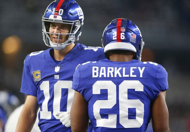 Sep 16, 2018; Arlington, TX, USA; New York Giants running back Saquon Barkley (26) and quarterback Eli Manning (10) on the field before the game against the Dallas Cowboys at AT&T Stadium.