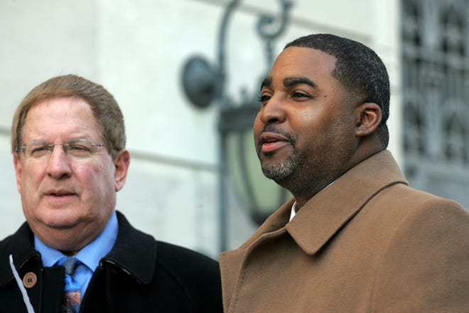 Tuesday December 18, 2007 --- Trenton ---- Attorney Miles Feinstein and former Passaic City Councilman Marcellus Jackson outside of the federal courthouse in Trenton after Jackson pleaded guilty to federal corruption charges.