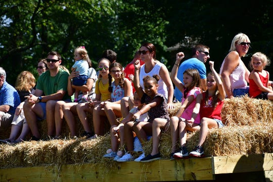 Youngsters enjoy a hayride.