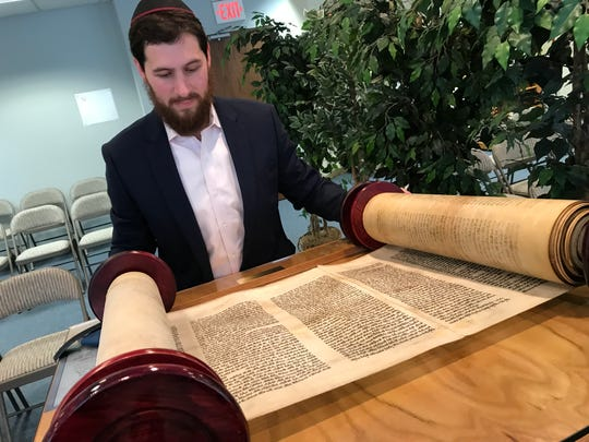 A Torah saved from Hamburg, Germany during the the Night of Broken Glass in 1938 is in Wanaque N.J. on Sept. 17 as Rabbi Mendy Gurkov prepares to use the scroll as the centerpiece of his 2018 Yom Kippur service.