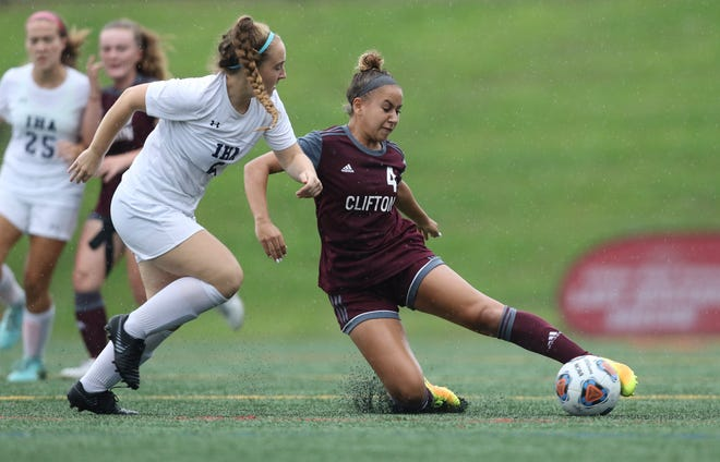 Leila Ettayebi, of Clifton, sliding on the ground to get to the ball before Alex Daugherty of Immaculate Heart.