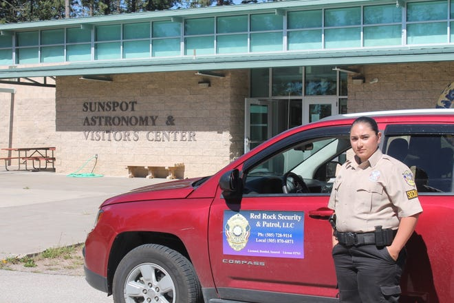 Red Rock Security guard Angel Escalante stands in front of the Sunspot Astronomy and Visitor's Center, which reopened Monday, Sept. 17, 2018. Red Rock was set to have guards at the observatory for the rest of the week.