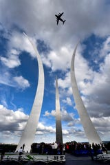 A C-17 Globemaster III flies over the Air Force Memorial during the 70th Anniversary of Berlin Airlift wreath laying ceremony Arlington, Virginia, Sept. 16, 2018.  The Berlin Airlift, a herculean humanitarian airlift effort, broke the Soviet Union's blockade of West Berlin and shattered previous airlift records, breaking the airlift barrier. The same hard work and determination by those Airmen continue today as Mobility Airmen are in 23 countries and 77 locations around the world. They continue to enable global access for allies and joint operations though 24 hours-a-day, seven-days-a-week operations with a mobility aircraft.