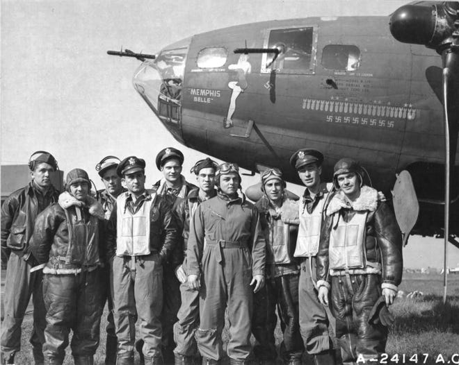 """The crew of the Boeing B-17 """"Memphis Belle"""" is pictured at an air base in England after completing 25 missions over enemy territory. The crew, left to right: Tech. Sgt. Harold P. Loch, Staff Sgt. Cecil H. Scott, Tech. Sgt. Robert J. Hanson, Capt. James A. Verinis, Capt. Robert K. Morgan, Capt. Charles B. Leighton, Staff Sgt. John P. Quinlan, Staff Sgt. Casimer A. Nastal, Capt. Vincent B. Evans and Staff Sgt. Clarence B. Winchell returned to the U.S. to a hero's welcome and embarked on a 30 city morale tour."""