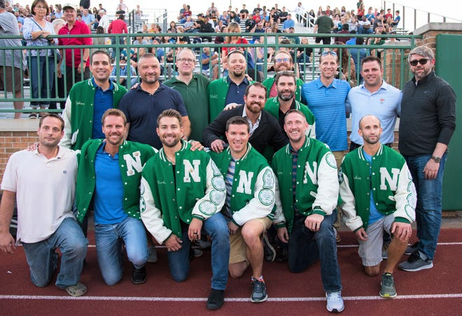 Members of the 1998 Division 1 state championship Novi boys soccer team stage their 20-year reunion.