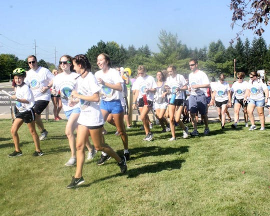 The first group of 22 runners/walkers embark on their 3.1-mile journey.