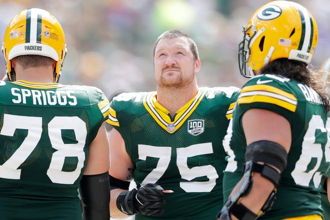 Green Bay Packers offensive tackle Bryan Bulaga (75) looks up at the video board at Lambeau Field on Sunday, September 16, 2018 in Green Bay, Wis.Adam Wesley/USA TODAY NETWORK-Wisconsin