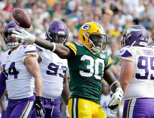 Green Bay Packers running back Jamaal Williams (30) signals for a 1st down against the Minnesota Vikings at Lambeau Field on Sunday, September 16, 2018 in Green Bay, Wis.
