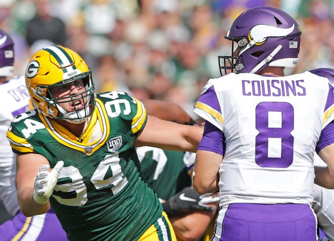 Green Bay Packers defensive end Dean Lowry (94) pressures Minnesota Vikings quarterback Kirk Cousins (8) at Lambeau Field on Sunday, September 16, 2018 in Green Bay, Wis.