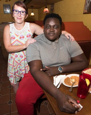 Kyle Clark, left, treats Sam Davilmar to lunch on Monday, Sept. 17, 2018, as a thank-you after the 22-old helped to rescue her father. Davilmar used his bare hands to extract Deputy Steven Clark from his mangled police cruiser after an accident on Friday.