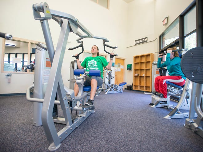 Assistant professor of Biology Kianni Gardner, left, works out on new equipment in the L.I.F.E. (Lifestyle Improvement Fitness Education) Center at the Pensacola State College Milton campus in Milton on Monday, September 17, 2018.