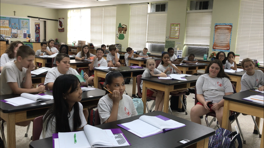 Sixth-grade students study in science class at Little Flower Catholic School on Monday, Sept. 17, 2018.