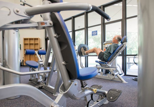 Roy Harris, a 20-year member of the gym, works out on new equipment in the L.I.F.E. (Lifestyle Improvement Fitness Education) Center at the Pensacola State College Milton campus in Milton on Monday, September 17, 2018.