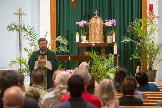 The Rev. Matt Worthen celebrates Mass Sunday, Sept. 16, 2018, at Little Flower Catholic Church.