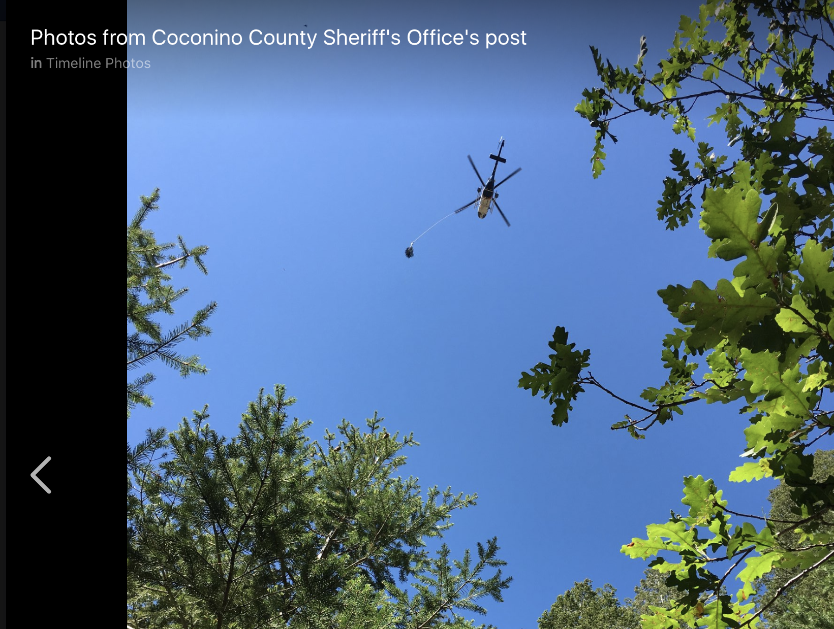 Rescue helicopter flying over ATV crash site near Payson