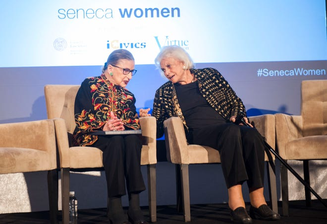 Supreme Court Justice Ruth Bader Ginsburg sits with Justice Sandra Day O'Connor at the Seneca Women Global Leadership Forum at the National Museum of Women in the Arts, on April 15, 2015, in Washington.
