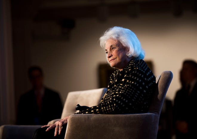 Justice Sandra Day O'Connor listens as Justice Ruth Bader Ginsburg pays tribute to O'Connor's advocacy work on behalf of civic education, impact on female judges and justice for women and girls worldwide at the Seneca Women Global Leadership Forum at the National Museum of Women in the Arts on April 15, 2015, in Washington.