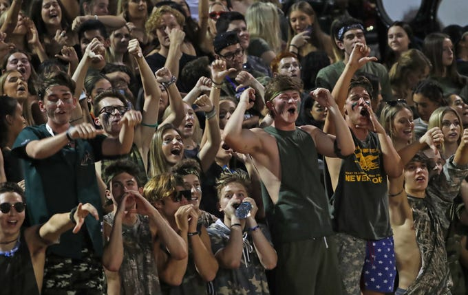 Chaparral fans boo Saguaro during the first half at Saguaro High School in Scottsdale, Ariz. on Sept. 14, 2018.