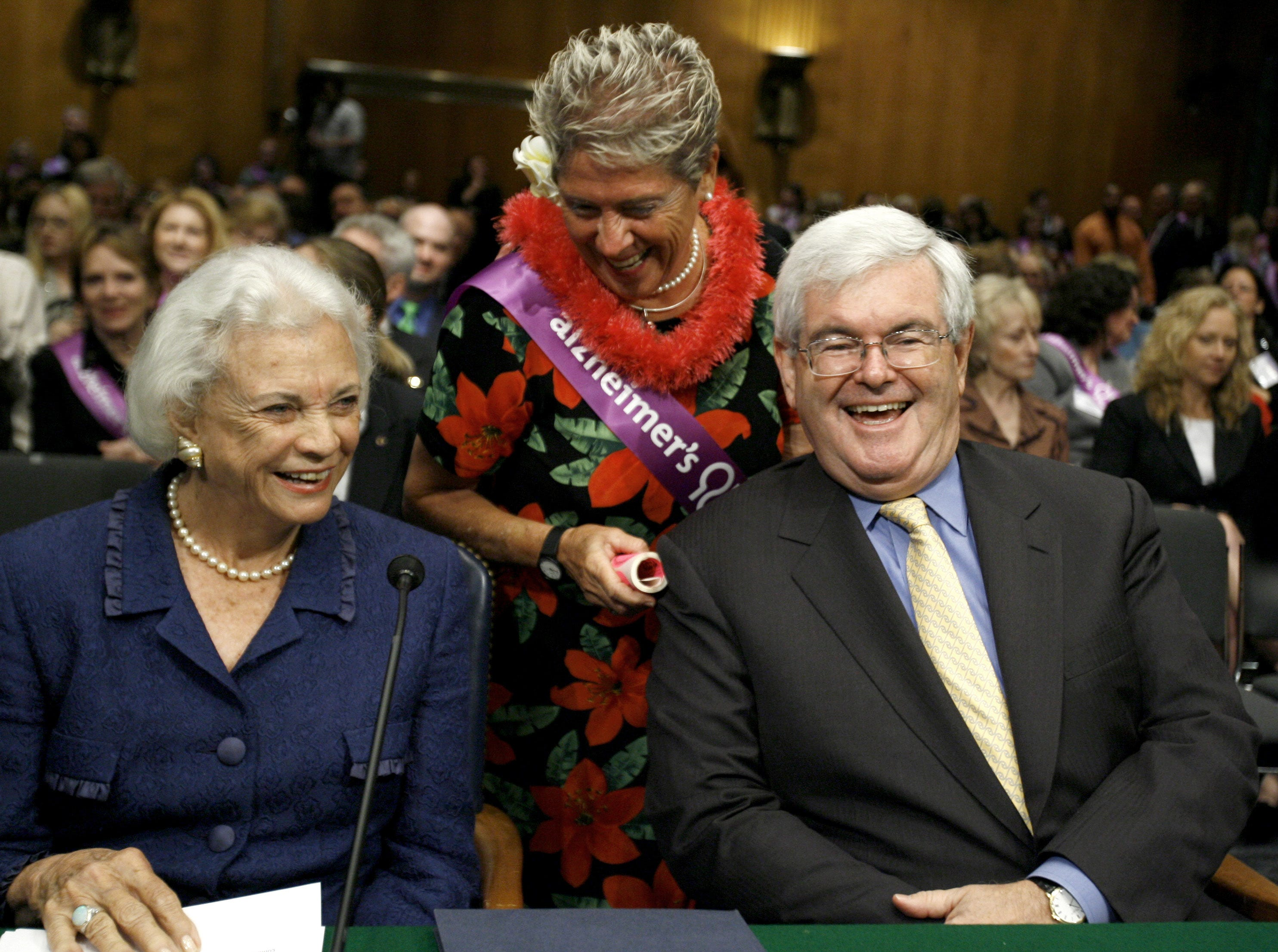 Former Supreme Court Justice Sandra Day O'Connor, left, and former House Speaker Newt Gingrich, right, share a laugh with Alzheimer's Association member Adele Rugg from Hawaii, Wednesday, May 14, 2008, on Capitol Hill in Washington, prior to the start of the Senate Special Committee on Aging hearing on Alzheimer's disease.