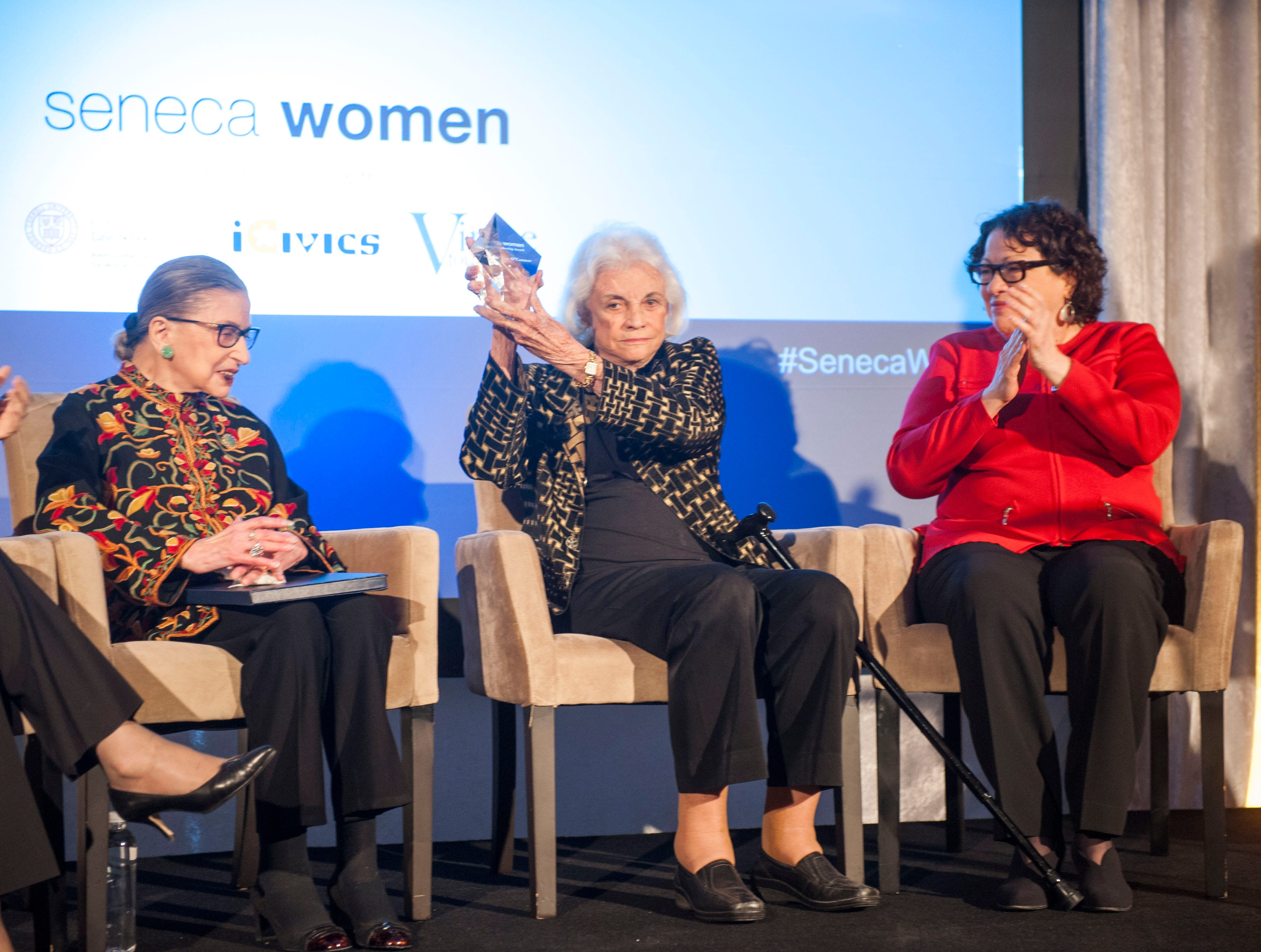 Justice Sandra Day O'Connor, center, holds her  Seneca Women Global Leadership Award as she sits with Supreme Court Justices Ruth Bader Ginsburg, and Sonia Sotomayor at the Seneca Women Global Leadership Forum on April 15, 2015 at the National Museum of Women in the Arts in Washington. O'Connor was honored for her advocacy work for civic education, impact on female judges and justice for women and girls worldwide.