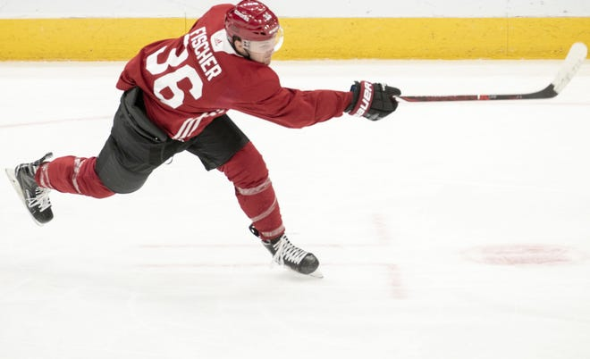Arizona Coyotes forward Christian Fischer takes a shot during a practice at Gila River Arena.