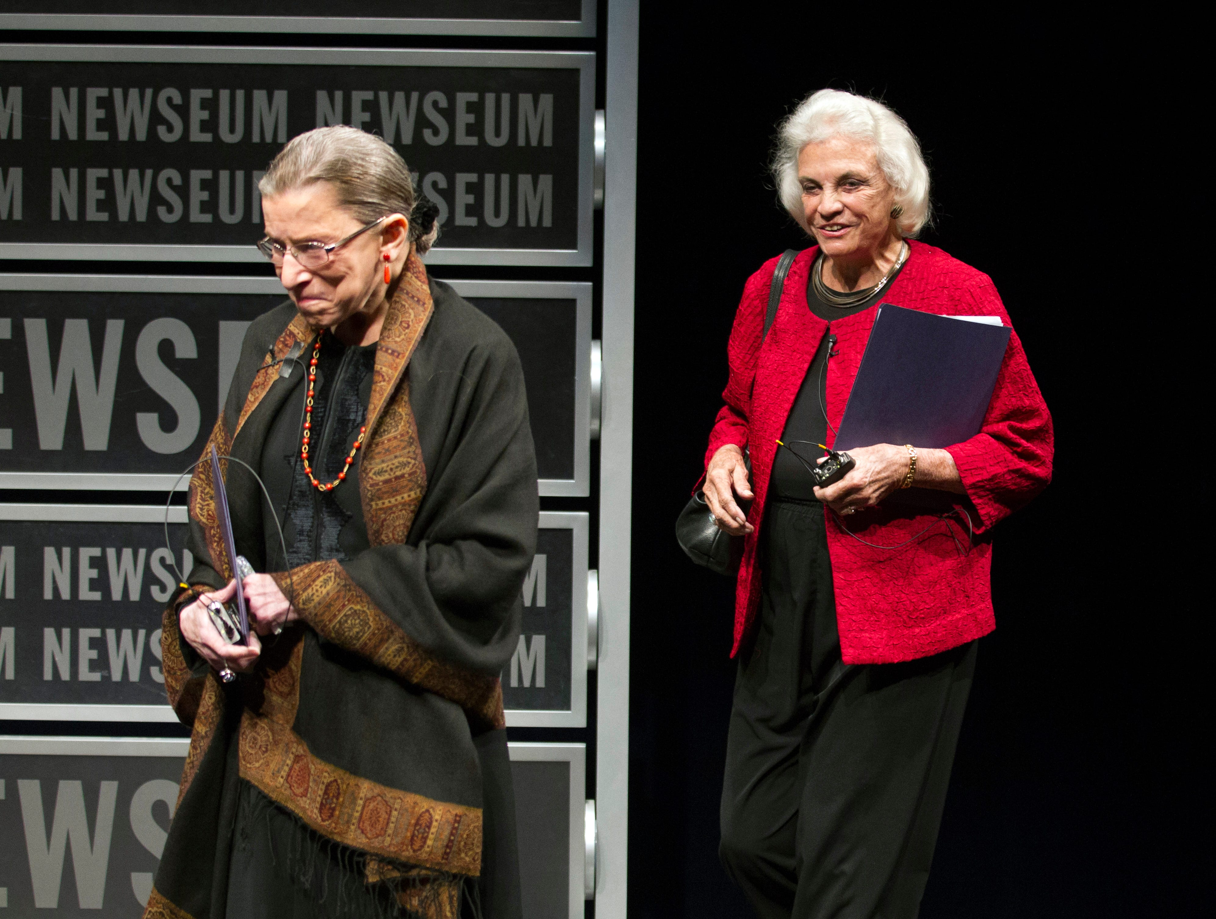 Former Supreme Court Justice Sandra Day O'Conno (right) arrives with Supreme Court Justice Ruth Bader Ginsburg, at a forum to celebrate the 30th anniversary of Sandra Day O'Connor's appointment to the Supreme Court, at the Newseum in Washington, on April 11, 2012.