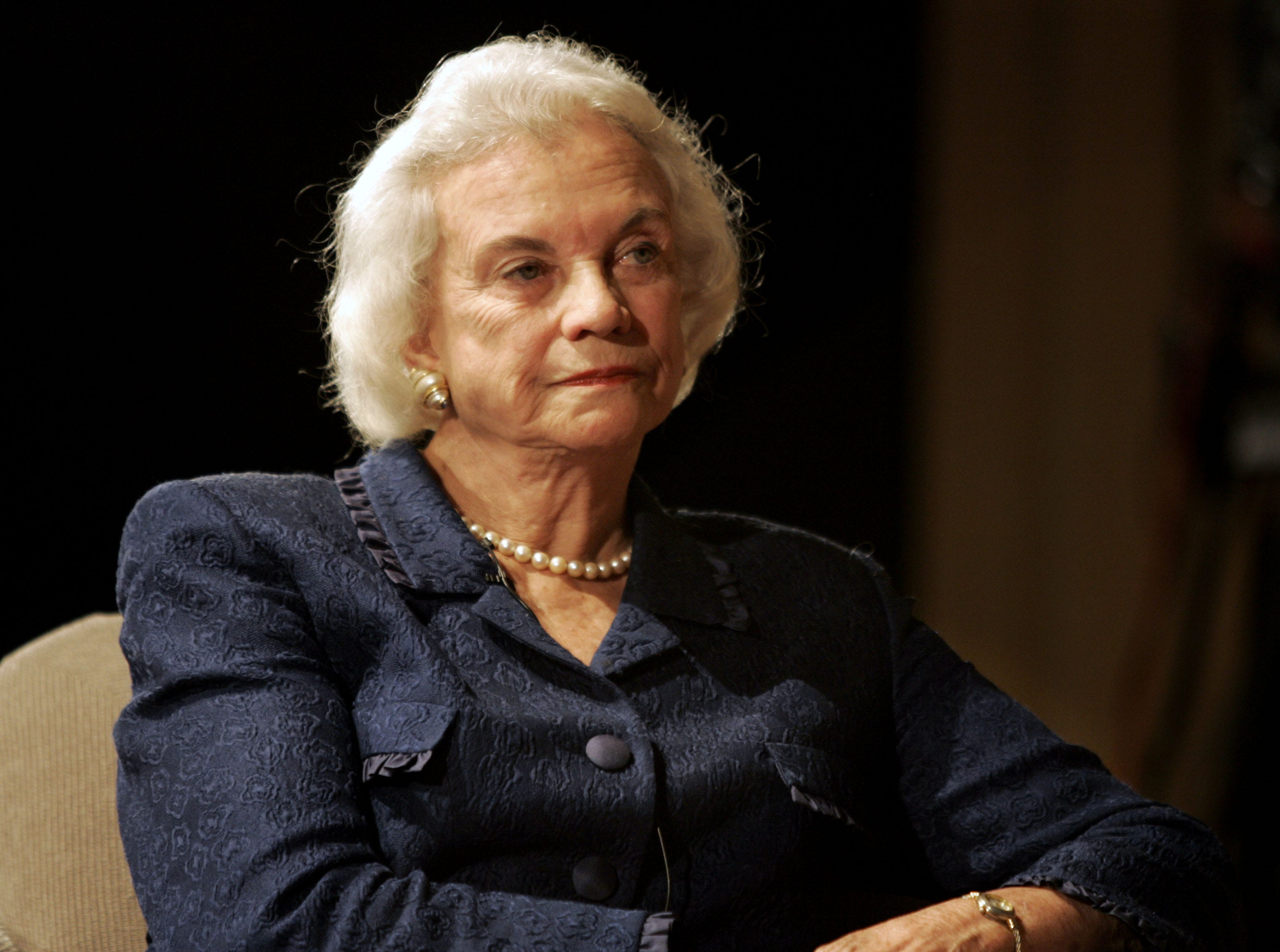 "Supreme Court Justice Sandra Day O'Connor pauses during a ""constitutional conversation"" with fellow justices  Antonin Scalia and Stephen Breyer at the National Archives on Thursday, April 21, 2005, in Washington, D.C."