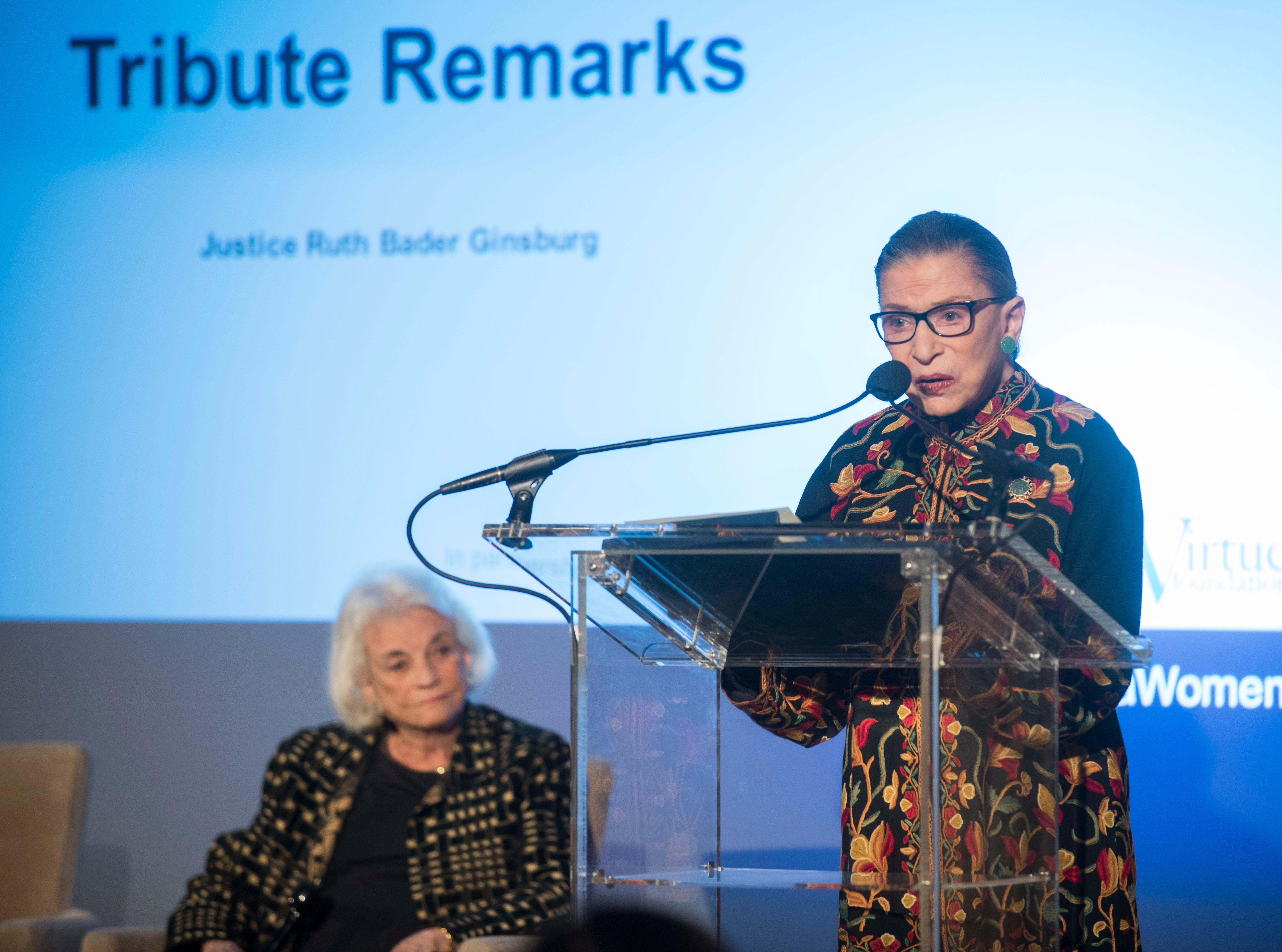 Supreme Court Justice Ruth Bader Ginsburg pays tribute to Justice Sandra Day O'Connor for her advocacy work on behalf of civic education, impact on female judges and justice for women and girls worldwide at the Seneca Women Global Leadership Forum at the National Museum of Women in the Arts, on April 15, 2015 in Washington.