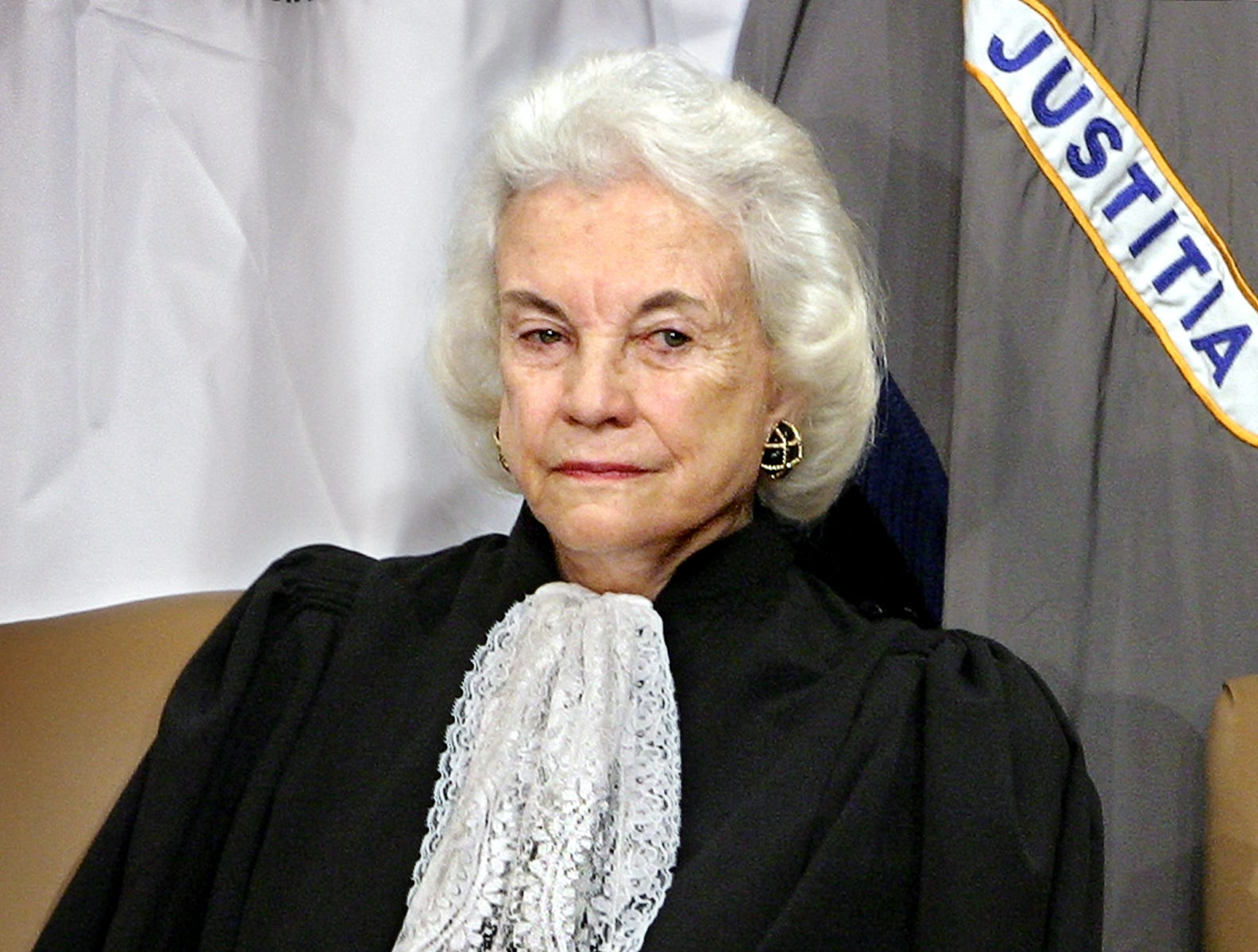 Supreme Court Associate Justice Sandra Day O'Connor listens to remarks by President Bush and U.S. Attorney General Alberto Gonzales after she administered the oath of office to Gonzales during an installation ceremony at the Justice Department in Washington, Feb. 14, 2005.