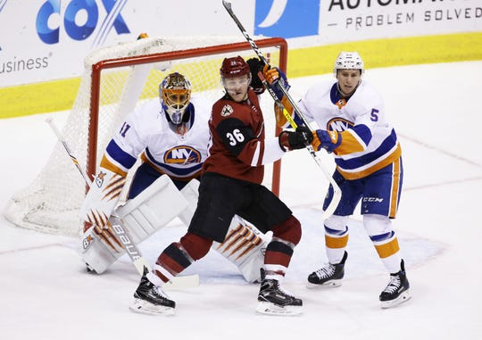 Coyotes forward Christian Fischer (36) sets up in front of the New York Islanders goal during a game on Jan. 22.