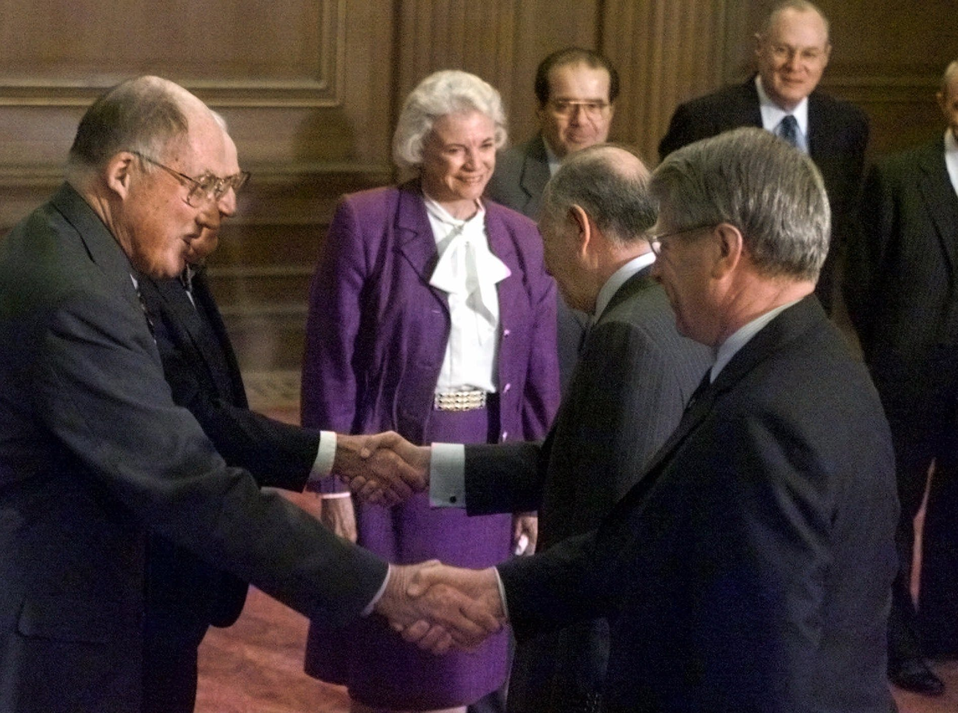 Chief Justice of the US Supreme Court William Rehnquist, left, and Associate Justice John Paul Stevens, partially visible on left, shake hands with the President of the Court of Justice of the European Communities, Spain's Gil Carlos Rodriguez Iglesias, center back, and President of the Fourth and Fifth Chambers of the Court of Justice, Britain's David Edward, during their visit to the Supreme Court in Washington, Tuesday April 18, 2000. Standing at back from left are Supreme Court Justices Sandra Day O'Connor, Antonin Scalia, Anthony Kennedy, and David Souter.