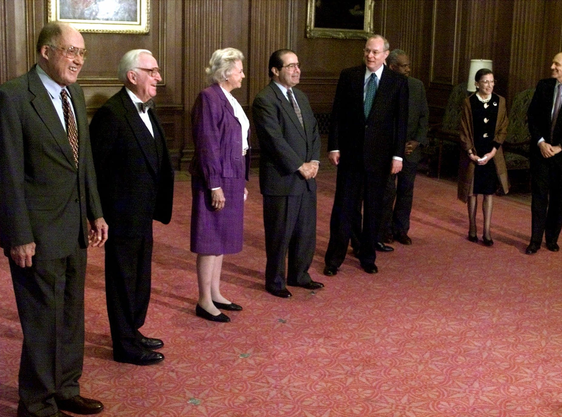 U.S. Supreme Court justices gather to meet with representatives of the Court of Justice of the European Communities at the Supreme Court in Washington, Tuesday April 18, 2000. From left, Chief Justice of the Supreme Court William Rehnquist and Justices John Paul Stevens, Sandra Day O'Connor, Antonin Scalia, Anthony Kennedy, David Souter (hidden), Clarence Thomas (partially hidden), Ruth Bader Ginsburg and Stephen Breyer.