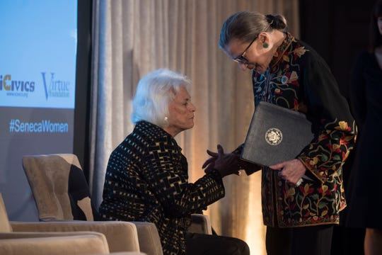Supreme Court Justice Ruth Bader Ginsburg embraces Justice Sandra Day O'Connor after paying tribute to O'Connor for her advocacy work on behalf of civic education, impact on female judges and justice for women and girls worldwide at the Seneca Women Global Leadership Forum at the National Museum of Women in the Arts, on April 15, 2015 in Washington.