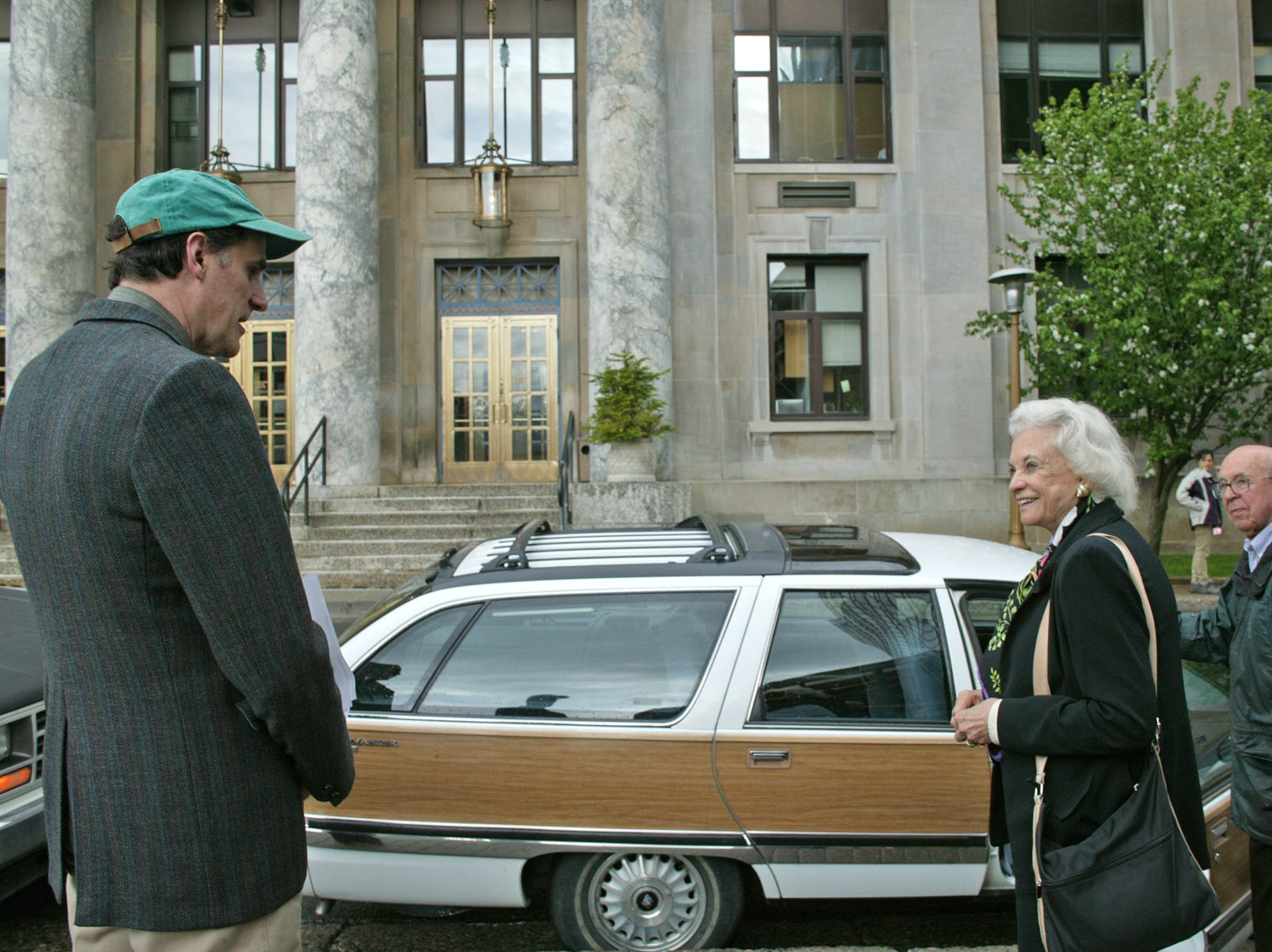 Rep. Bruce Weyhrauch, R-Juneau, (left) bids farewell to U.S. Supreme Court Justice Sandra Day O'Connor after she visits the Dimond Courthouse with retired Superior Court Judge Thomas Stewart on May 13, 2005, across from the Capitol in Juneau, Alaska. The Alaska Bar Association finished its three-day convention Friday at Centennial Hall, where O'Connor was invited to speak and present the American Judicature Society's Herbert Harley Award to Judge Stewart. The last time she visited Juneau was in 1952.