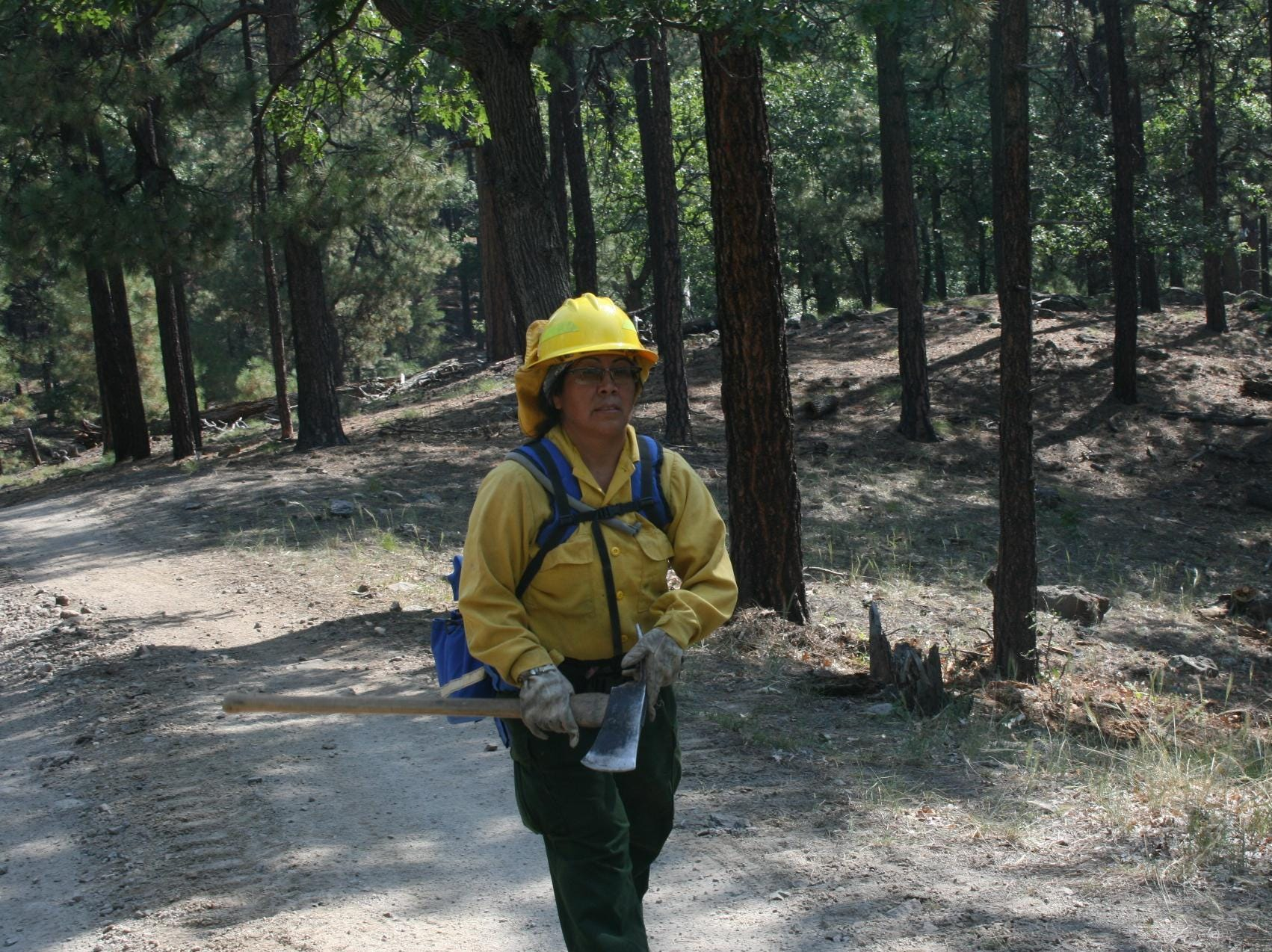 Crew members prepare the fire line on the Platypus Fire.