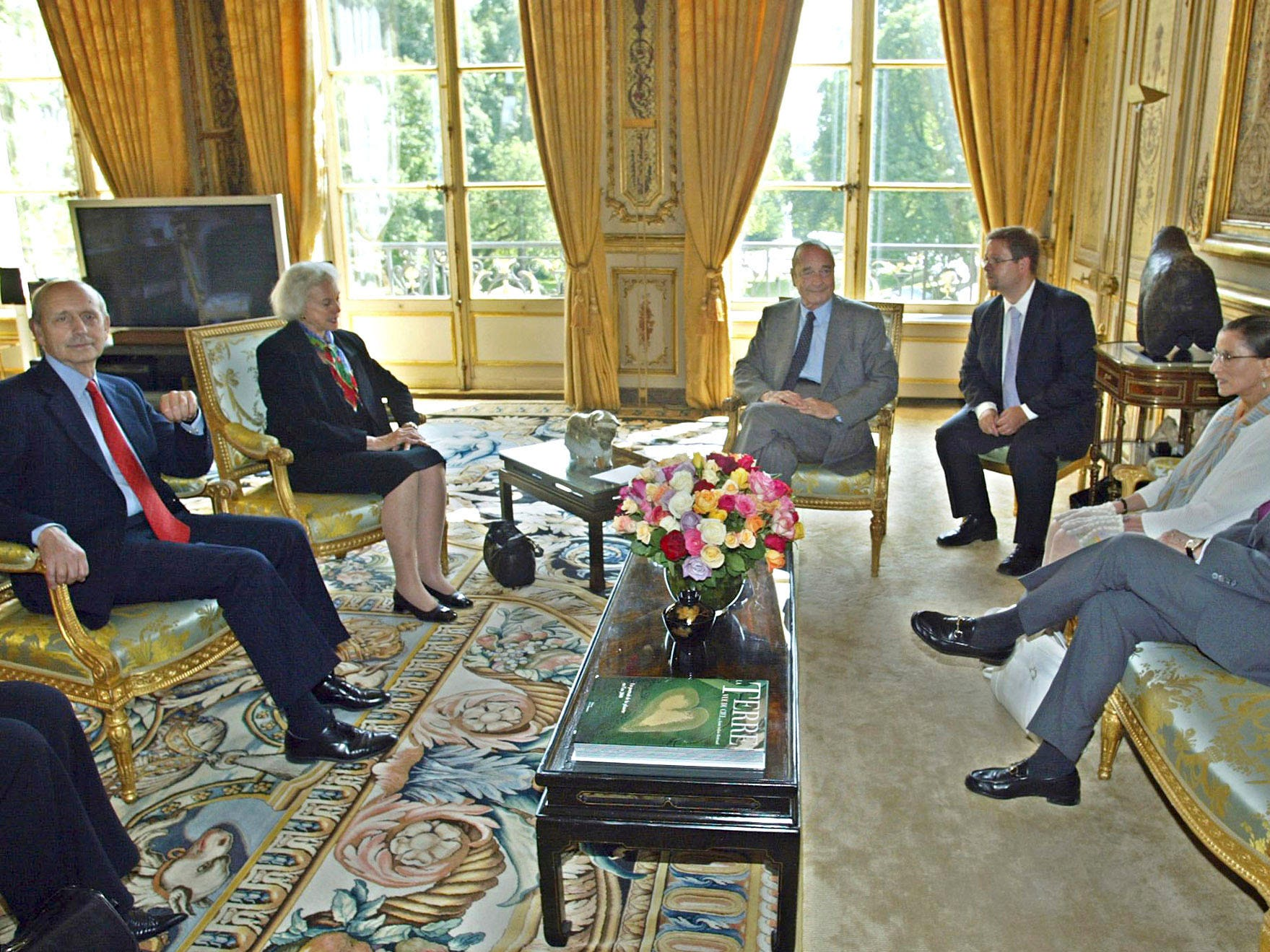 French President Jacques Chirac, center,  listens to U.S Supreme Court judges, from left, Stephen Breyer, Sandra Day O'Connor, Ruth Bader-Ginsburg and U.S Ambassador to France Howard H. Leach, right in Paris, Tuesday July 8, 2003. Third from the right is an unidentified interpreter.