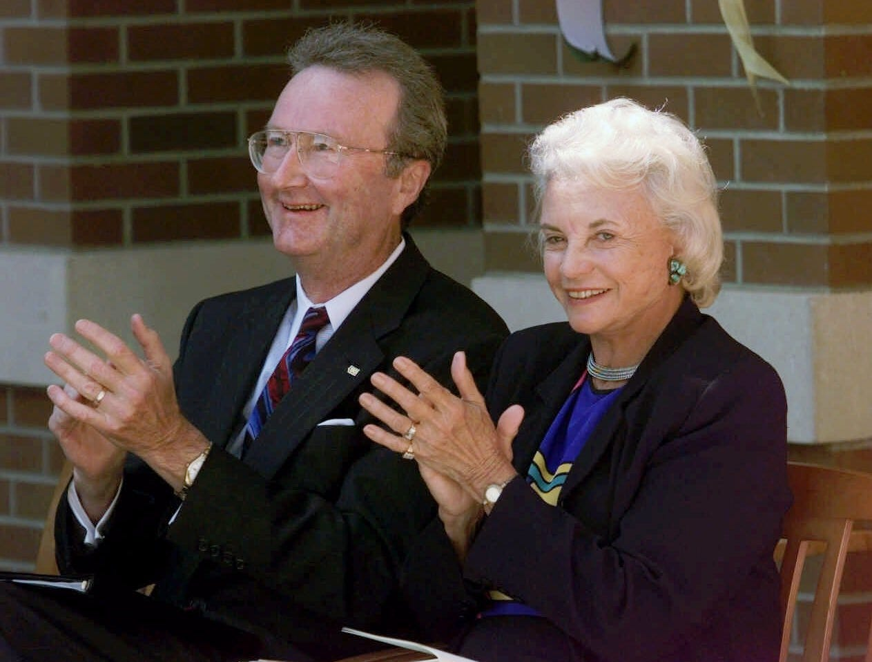 U.S. Supreme Court Justice Sandra Day O'Connor laughs with University of Oregon President Dave Frohnmayer in Eugene, Ore., Wednesday, Sept. 15, 1999, during the dedication ceremony for the new William W. Knight Law School Building.