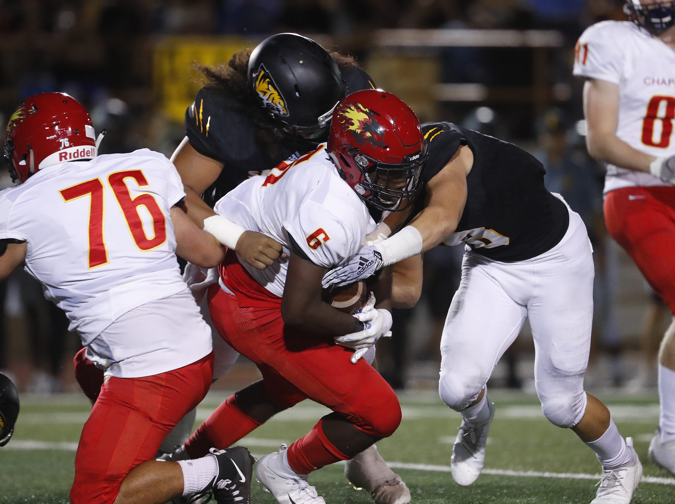 Saguaro tackles Chaparral's Darvon Hubbard (6) during the first half at Saguaro High School in Scottsdale, Ariz. on Sept. 14, 2018.