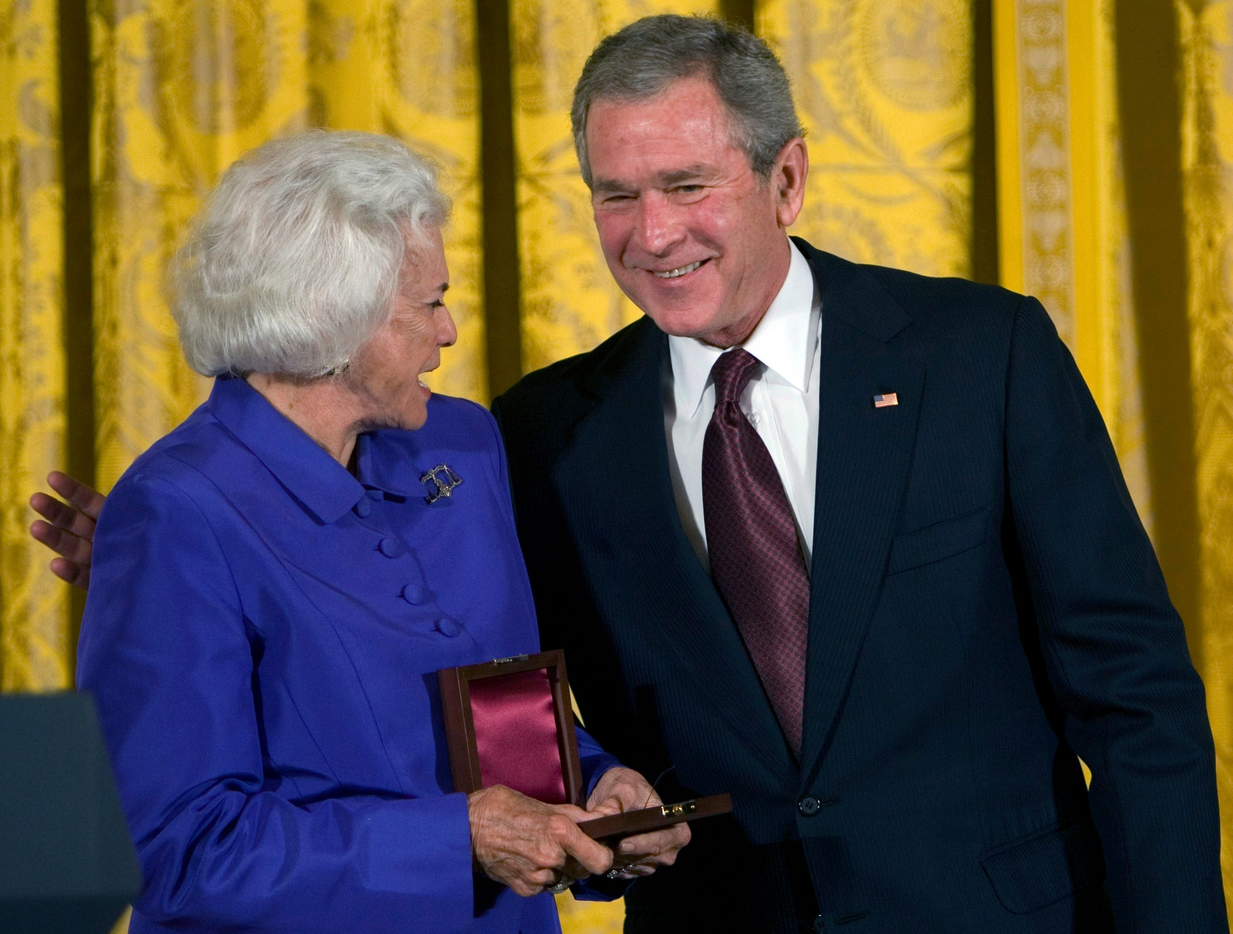 President Bush presents The Lincoln Medal to retired Supreme Court Justice Sandra Day O'Connor, left, during  a ceremony in honor of Abraham Lincoln's 199th birthday, in the East Room of the White House in Washington, Sunday, Feb. 10, 2008.